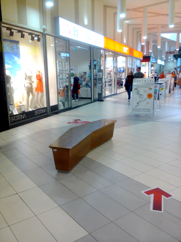 Bench in a shoping mall hall